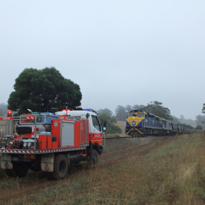 A Robertson RFS vehicle passes a freight train